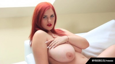 Sexy Red-Haired Woman Undressed While Smoking