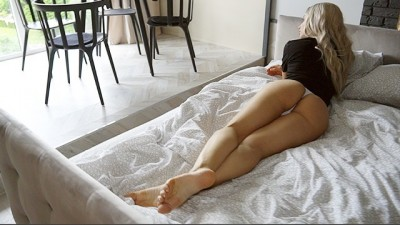 Sexy Blonde Lies On Bed
