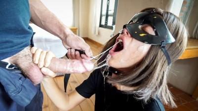 Blindfolded masked girl giving blowjob